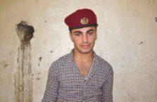 Iracki Kurdystan - młody mężczyzna w Lalish.