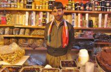 Iracki Kurdystan - sprzedawca słodyczy.